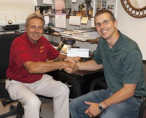 Ron Deiter receives check from Ryan Sauer, Flint Hills Resources