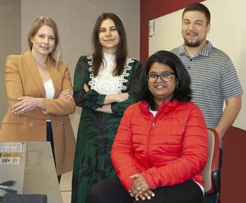 Anni Isojaervi ('20 PhD econ), Meenakshi Shekhar, Ganna Prykhodko, and Levi Soborowicz.