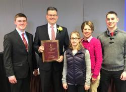 John Latham wins Outstanding Alum award.